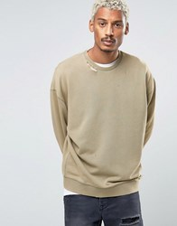 Asos Oversized Sweatshirt With Ripped Neck In Washed Khaki Vetiver Green