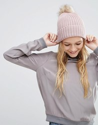 Asos Rib Beanie With Oversized Natural Faux Fur Pom Pink