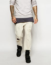 Asos Skinny Joggers In Rip And Repair With Raw Hem White