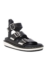 Givenchy Leather Rance Buckle Sandals In Black