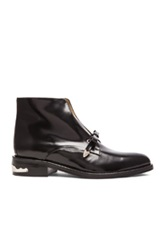 Toga Pulla Single Strap Patent Leather Booties In Black