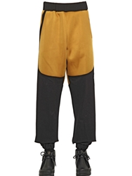 Astrid Andersen Shiny Neoprene And Cotton Jogging Trousers Mustard Black