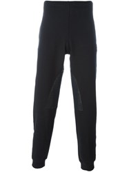 Alexander Mcqueen Perforated Panel Track Pants Black
