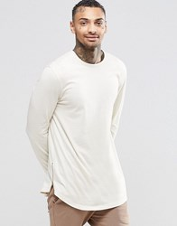 Asos Relaxed Longline Long Sleeve T Shirt With Curve Hem And Hem Zips In Off White Off White Cream