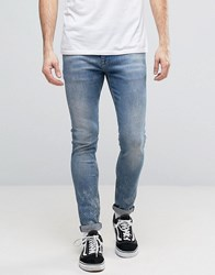 Asos Super Skinny Jeans In Mid Vintage Wash With Random Acid Wash Mid Blue