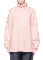 Tibi Oversized Cashmere Turtleneck Sweater Pink