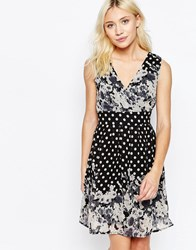 Yumi Sleeveless V Neck Skater Dress In Border Print Black