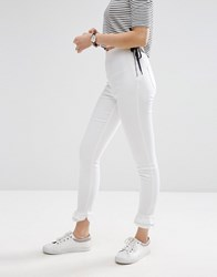 Asos Rivington High Waisted Denim Jeggings In White With Frill Hem White