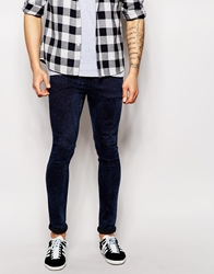 Asos Extreme Super Skinny Jeans In Overdyed Acid Wash Blue