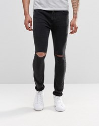 Pull And Bear Super Skinny Jeans In Washed Black With Knee Rips Black