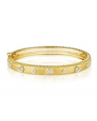Penny Preville 18K Gold Bangle With Round And Pear Shaped Diamond Stations