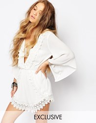 Kiss The Sky Playsuit With Plunge Neck And Lace Trim Cream