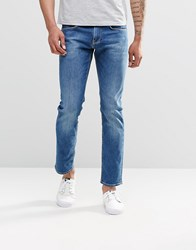 Tommy Hilfiger Jeans In Slim Fit Mid Wash Blue