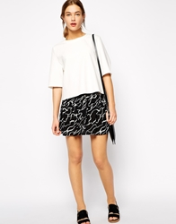 Ganni Mini Skirt In Swiggle Print Black