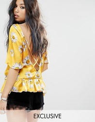 Milk It Vintage Short Sleeve Top With Ruffle Hem And Deep V Strappy Back In Festival Daisy Print Yellow