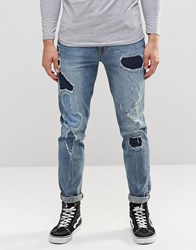 Asos Skinny Jeans With Rip And Repair Detail In Mid Blue Mid Blue