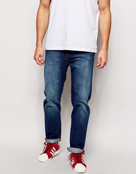 Asos Stretch Tapered Jeans In Mid Wash Midblue