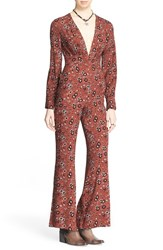 Women's Free People 'Some Like It Hot' Jumpsuit Rust Combo