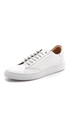 Wings Horns Low Top Sneakers