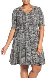 Gabby Skye Plus Size Women's Zip Detail Knit Jacquard Fit And Flare Dress