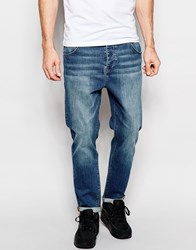 Asos Stretch Tapered Jeans In Green Caste Mid Blue Mid Blue