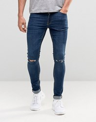 Asos Extreme Super Skinny Jeans With Knee Rips In Dark Wash Dark Blue