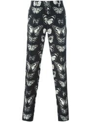 Alexander Mcqueen Moth Jacquard Trousers Black