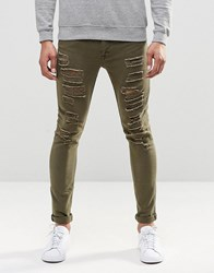 Asos Super Skinny Jeans With Extreme Rips In Light Green Burn Olive