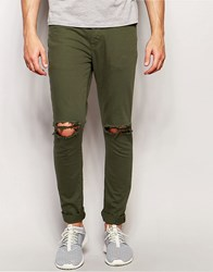 Asos Super Skinny Jeans With Knee Rips In Green Thyme