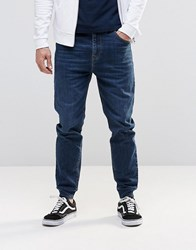 Asos Slim Tapered Jogger Jeans In Mid Blue Mid Blue