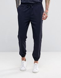 Pull And Bear Pullandbear Cuffed Trousers With Check Print In Navy Navy Blue