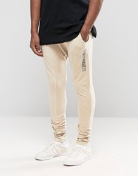 Criminal Damage Skinny Joggers With Drop Crotch Beige