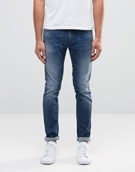 Sisley Super Skinny Distressed Jeans In Mid Wash Blue Mid Wash