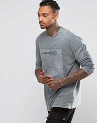 Asos Oversized Long Sleeve T Shirt With Woven Pocket And Acid Wash Blue