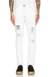 Palm Angels Regular Fit Ripped Jeans In Blue