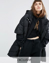 Puffa Oversized Cape Jacket With Padded Collar And Hood In Tonal Leopard Black