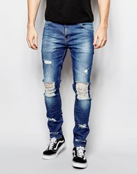 Asos Super Skinny Jeans With Extreme Knee Rips Mid Blue