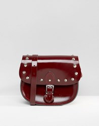 Leather Satchel Company The Studded Saddle Bag Patent Oxblood Red