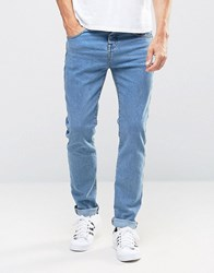 Pull And Bear Pullandbear Skinny Tapered Jeans In Mid Blue Mid Blue Navy
