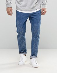 Asos Relaxed Tapered Jeans In Mid Wash With Random Acid Mid Blue
