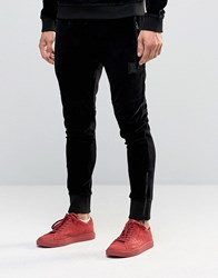 Religion Jersey Joggers In Slim Fit With Metal Badge And Zip Cuff Black