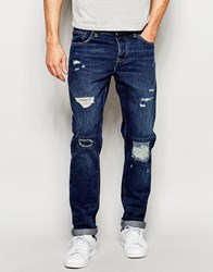 Asos Slim Jeans With Rip And Repair In Mid Blue Blue
