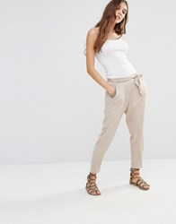 Honey Punch Peg Leg Trousers With Big Bow Detail Cream