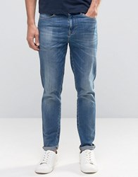 Asos Skinny High Rise Jeans In Mid Wash Mid Blue