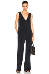 Nomia V Neck Jumpsuit In Blue Black