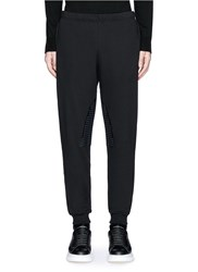 Alexander Mcqueen Perforated Leather Patch Jogging Pants Black