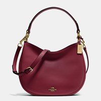 Coach Nomad Crossbody In Glovetanned Leather Light Gold Burgundy