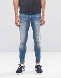 Asos Extreme Super Skinny With Abrasion In Light Blue Wash Light Blue