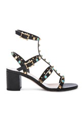 Valentino Rockstud Leather Rolling Gladiator Sandals In Black