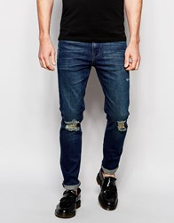 Asos Skinny Jeans In Tinted Dark Wash With Rips Blue